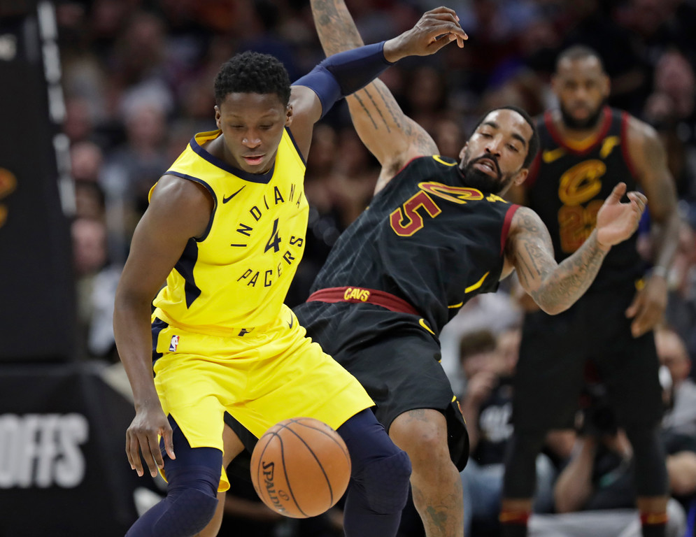 . Indiana Pacers\' Victor Oladipo (4) drives against Cleveland Cavaliers\' JR Smith (5) during the first half of Game 2 of an NBA basketball first-round playoff series Wednesday, April 18, 2018, in Cleveland. (AP Photo/Tony Dejak)