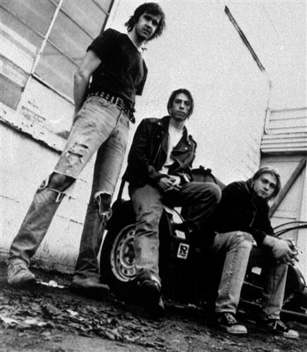 Description of . FILE - Members of the band Nirvana shown in a 1991 file photo, from left, Krist Novoselic, David Grohl, and Kurt Cobain.  Nirvana, Linda Ronstadt, Peter Gabriel, Hall and Oates, and The Replacements are among first-time nominees to the Rock and Roll Hall of Fame. The hall of fame announced its annual list of nominees Wednesday morning, Oct. 16, 2013, and half the field of 16 were first-time nominees. (AP Photo/Chris Cuffaro, File)