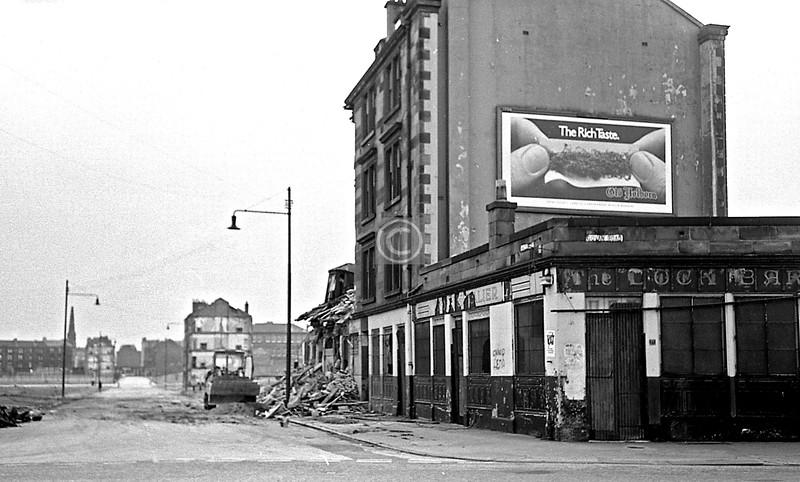 Couple of poor shots of the demolition in MacLean St.   June 1975