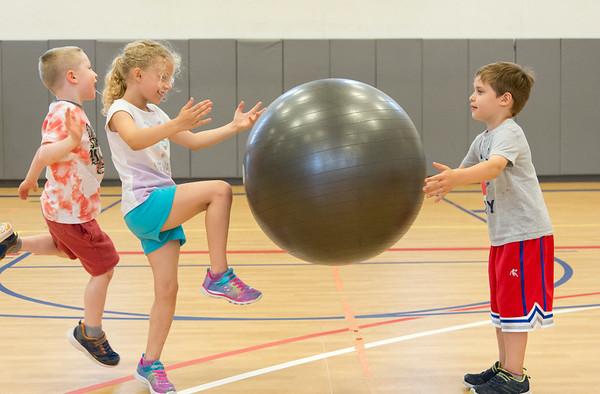 06/19/19 Wesley Bunnell | Staff Nathan O'Brien, L, jumps behind Kendyll Scoville as she passes the ball to Austin Hamelin during music and fitness class at the Bristol Boys and Girls Club summer camp on Wednesday June 19, 2019.