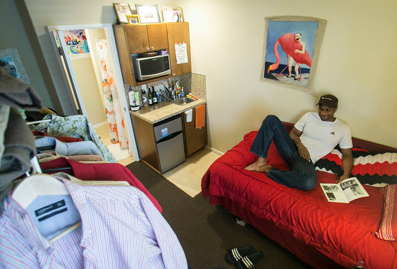 """. Jon-Christian Stubblefield relaxes inside of his 200 square foot Mini-Suite apartment in the First Hill neighborhood in Seattle, Washington May 12, 2013. \""""It was an affordable option living inside the city\'s core for under 1200,\"""" said Stubblefield who relocated to Seattle from Texas.  Micros, also known as \""""hostel-style\"""" apartments, usually offer less than 200 square feet (18.5 square metres) including private bathrooms, and they typically come furnished, sometimes with built-in beds and other amenities to save space.  REUTERS/Nick Adams"""