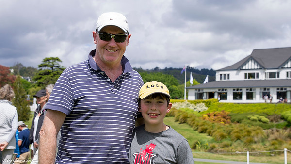 Conal Kelly and his dad Michael enjoying the action at the back of the 18th geen on the Michael final day of the Asia-Pacific Amateur Championship tournament 2017 held at Royal Wellington Golf Club, in Heretaunga, Upper Hutt, New Zealand from 26 - 29 October 2017. Copyright John Mathews 2017.   www.megasportmedia.co.nz