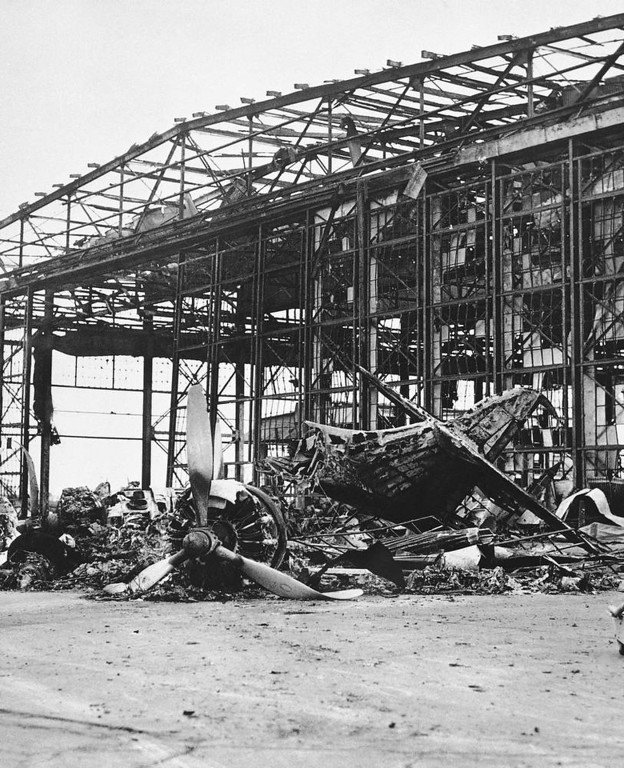 . One of the hangars that was burned out at the Naval Air Station on Ford Island, Pearl Harbor, Dec. 7, 1941. (AP Photo)