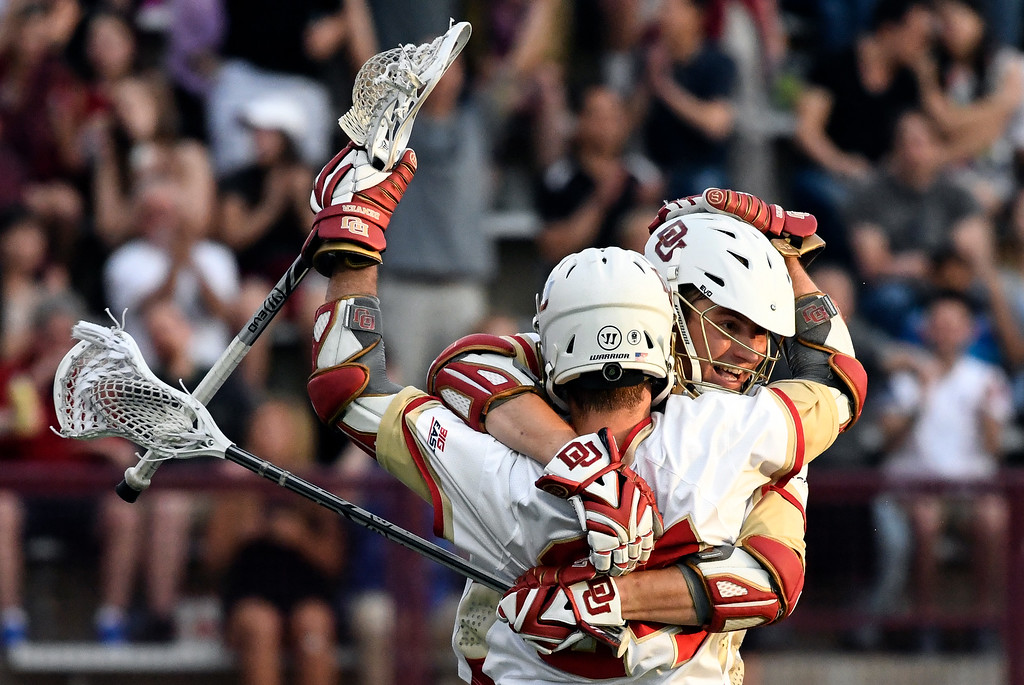 . DENVER, CO - MAY 05: Denver Colin Woolford (57) celebrates his goal with Denver Connor Donahue (24) during the first period against Providence in a Big East semifinal game May 5, 2016 at Peter Barton Lacrosse Stadium. (Photo By John Leyba/The Denver Post)