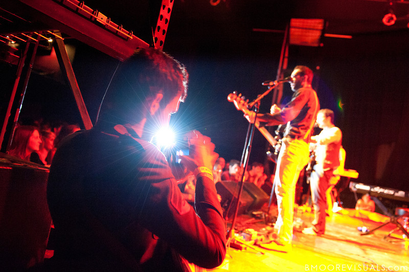 Brooks Potteiger photographs Julio Tavarez and Dan Nigro of As Tall As Lions during the band's performance on May 2, 2010 at State Theatre in St. Petersburg, Florida