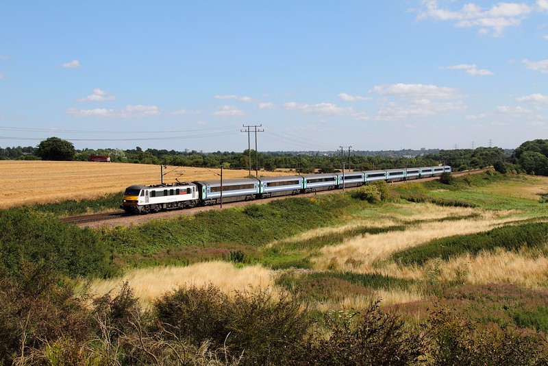 90012 on the 1P27 1000 Norwich to London Liverpool Street at Belstead bank on the 4th August 2015.JPG