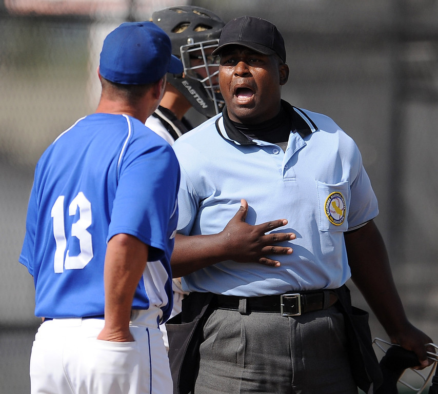 . Baldwin Park head coach Jake Barendregt talks with the home plate umpire in the fourth inning of a prep baseball game against Northview at Northview High School on Tuesday, April 23, 2012 in Covina, Calif. Northview won 8-2.    (Keith Birmingham/Pasadena Star-News)