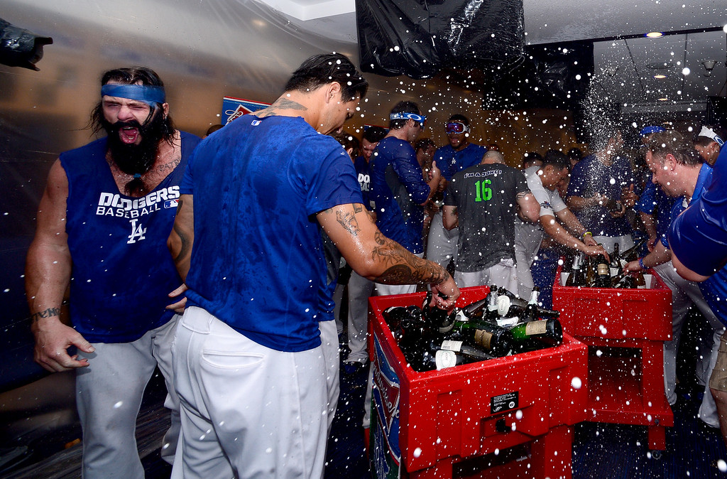 . The Los Angeles Dodgers celebrate winning the NLDS in Dodger Stadium\'s club house Monday night, October 7, 2013. Dodgers defeated the Atlanta Braves 4-3 in the fourth game. (Photo by Sarah Reingewirtz/Los Angeles Daily News)