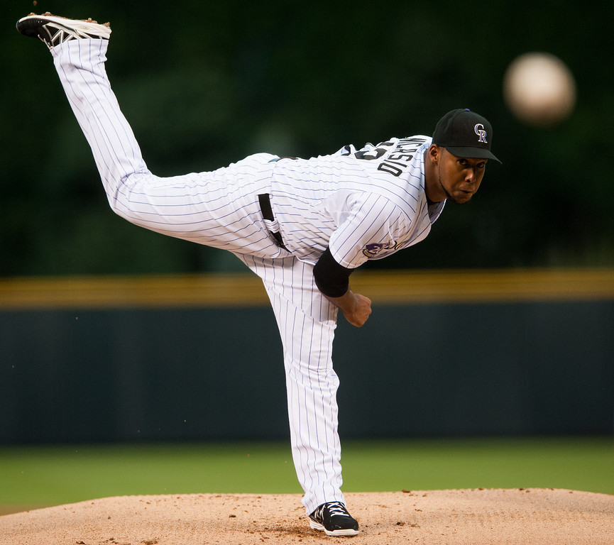 . DENVER, CO - AUGUST 31:  Juan Nicasio #12 of the Colorado Rockies delivers a pitch in the first inning of a game against the Cincinnati Reds at Coors Field on August 31, 2013 in Denver, Colorado. The Rockies beat the Reds 9-6. (Photo by Dustin Bradford/Getty Images)