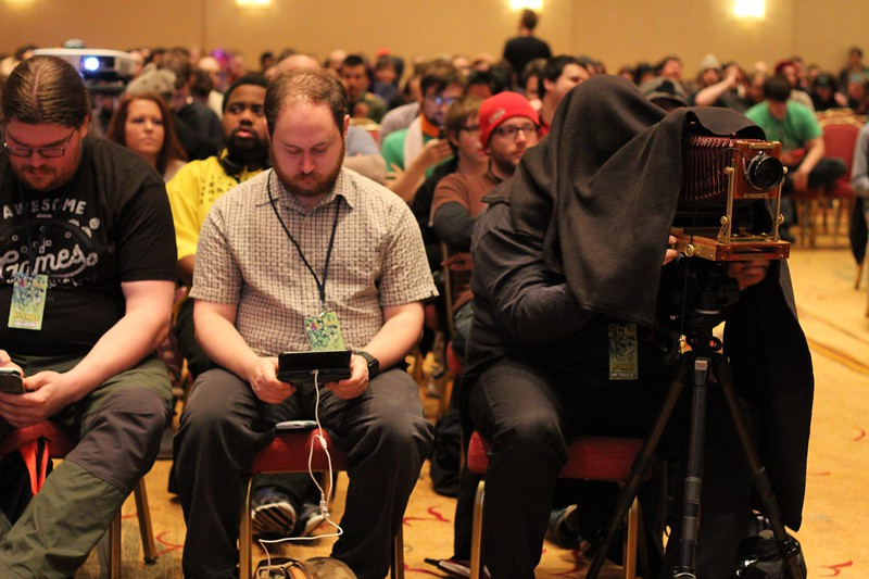 guy with old camera sitting next to a guy with a 3ds.jpg