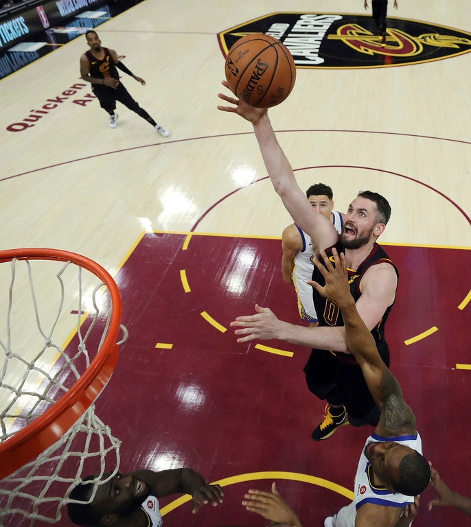. Cleveland Cavaliers\' Kevin Love shoots during the first half of Game 3 of basketball\'s NBA Finals against the Golden State Warriors, Wednesday, June 6, 2018, in Cleveland. (Gregory Shamus/Pool Photo via AP)