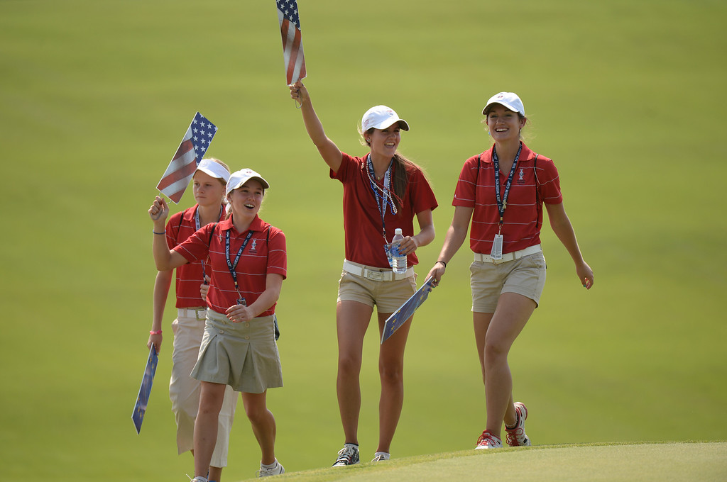 . PARKER, CO. - August 16: Youths ask cheering for team USA on 9th fairway during 2013 Solheim Cup at Colorado Golf Club. Parker, Colorado. August 16, 2013. (Photo By Hyoung Chang/The Denver Post)