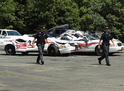Farmer-smashes-7-police-cruisers-with-tractor-Q1209105-x-large.jpg