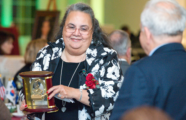 09/27/18 Wesley Bunnell | Staff The Immigrant Heritage Hall of Fame 2018 Gala and Induction Ceremonies was held on Thursday night at The Aqua Turf Club. Dr. Daisy Cocco De Filippis smiles as she carries her award back to her table full of family and friends.