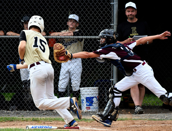 7/11/2018 Mike Orazzi | Staff Edgewood's Ryan Fradette (15) tagged out by Killingly's Riley Zadora (2) in the Senior League state championship at Barnes Field in Bristol Wednesday night.
