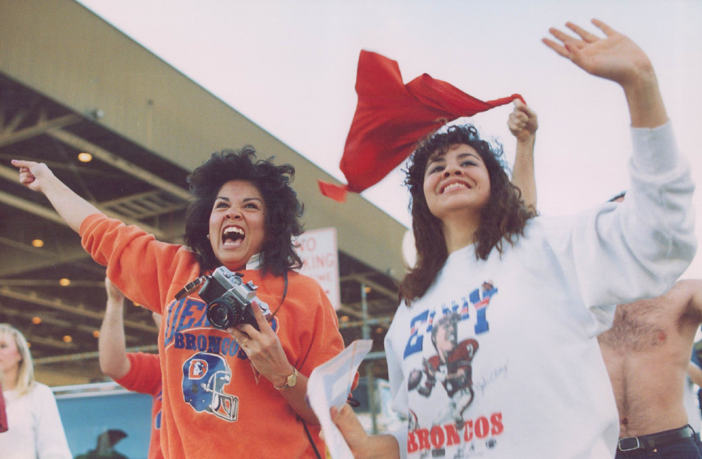 . 11-1988 - San Diego, Jan. 25 - Denverites Theresa and Traci Najarin cheer as the Denver Broncos team bus passes by after arriving at the San Diego airport. (Damien Strohmeyer/The Denver Post)