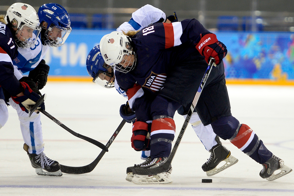 . U.S.A. player Lyndsey Fry (18) battles Finland\'s Karoliina Rantamaki for the puck during the third period of the United States\' 3-1 win against Finland. Sochi 2014 Winter Olympics on Saturday, February 8, 2014. (Photo by AAron Ontiveroz/The Denver Post)