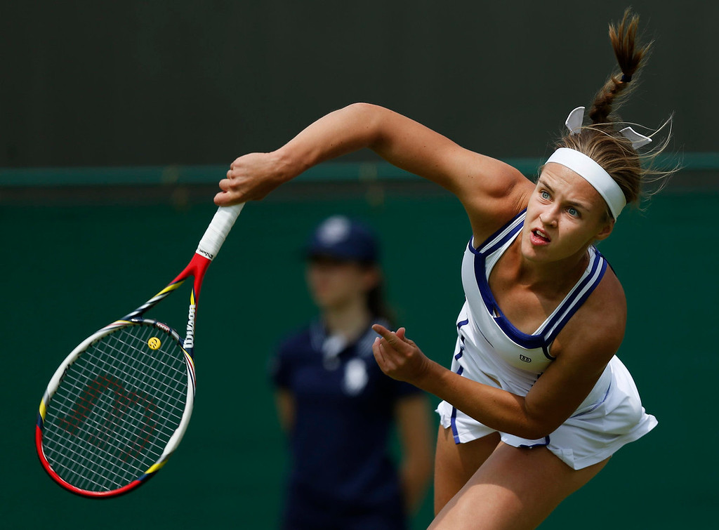. Anna Schmiedlova of Slovakia serves to Samantha Stosur of Australia during their Women\'s first round singles match at the All England Lawn Tennis Championships in Wimbledon, London,  Tuesday, June 25, 2013.  (AP Photo/Sang Tan)