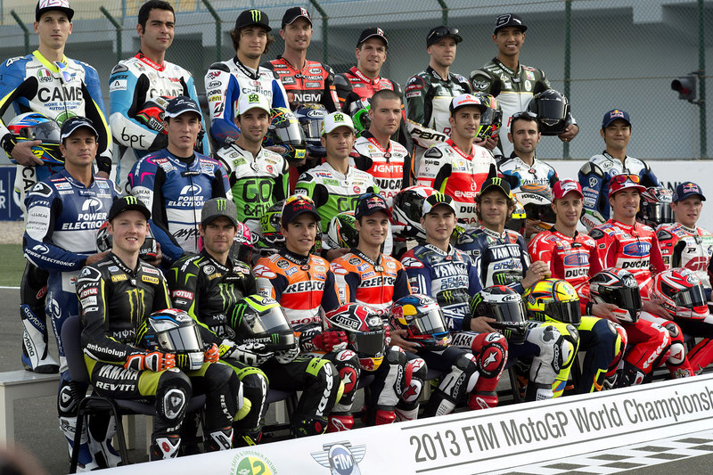 . The 2013 MotoGP riders pose on the track for photographers during the MotoGp of Qatar - Previews at Losail Circuit on April 4, 2013 in Doha, Qatar.  (Photo by Mirco Lazzari gp/Getty Images)