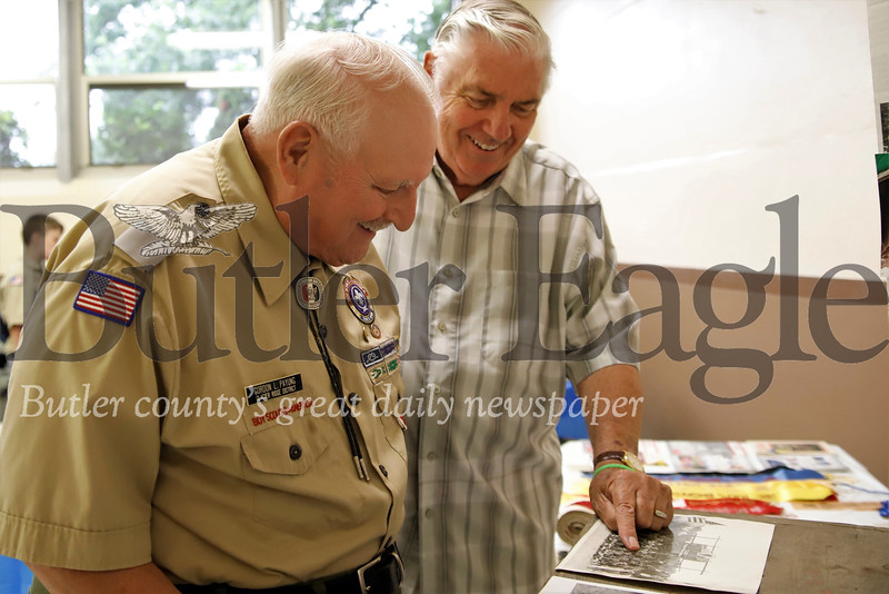 Gordon Payung, 82, and Jim Diamond, 82, look at old photos of Boy Scout Troup 19. The two former scouts both joined the troup in the 1940s. Active and former scouts celebrated the troop's 100th anniversary Saturday. Seb Foltz/Butler Eagle