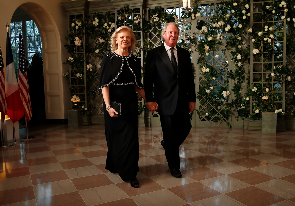 . Virginia Rometty and Anthony Mark Rometty arrive for a State Dinner with French President Emmanuel Macron and President Donald Trump at the White House, Tuesday, April 24, 2018, in Washington. (AP Photo/Alex Brandon)