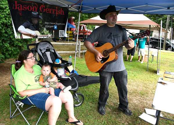 7/11/2018 Mike Orazzi | Staff Jason Gerrish along with his wife Jenna and son Waylon during the Bristol Farmers Market on the Federal Hill Green Wednesday afternoon.