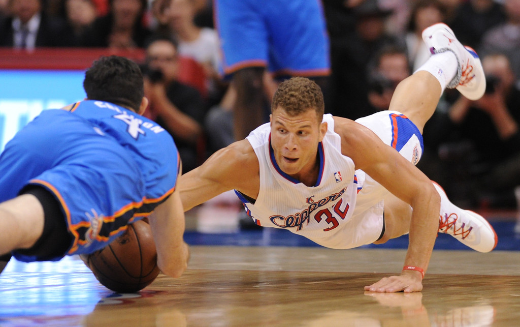 . Thunder#4 Nick Collison and Clippers#32 Blake Griffin dive for a ball in the first quarter. The tie up resulted in a jump ball. The Los Angeles Clippers played the Oklahoma City Thunder in a regular season game at Staples Center in Los Angeles, CA. 4/9/2014(Photo by John McCoy / Los Angeles Daily News)