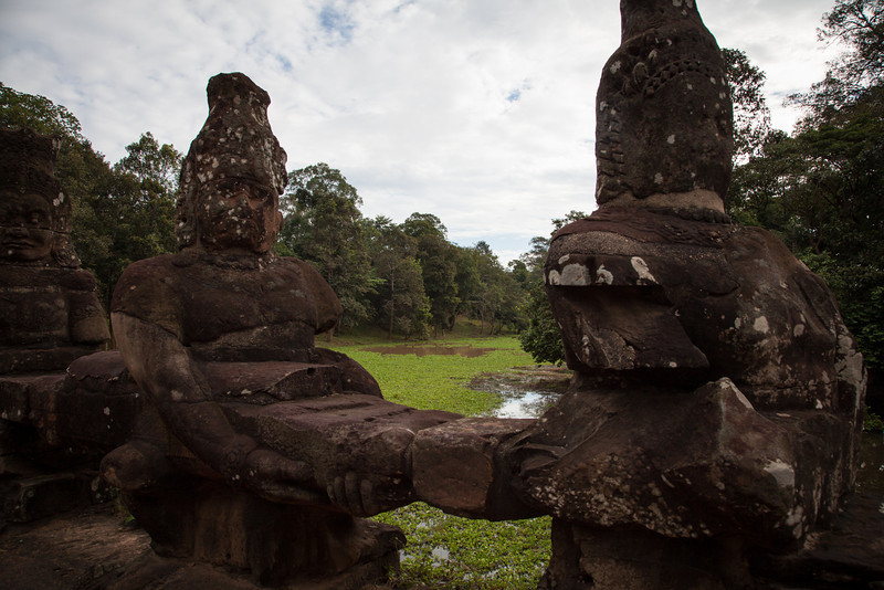 Demons holding the body of a naga flank the right side of the causeway leading to the south gate of Angkor Thom.