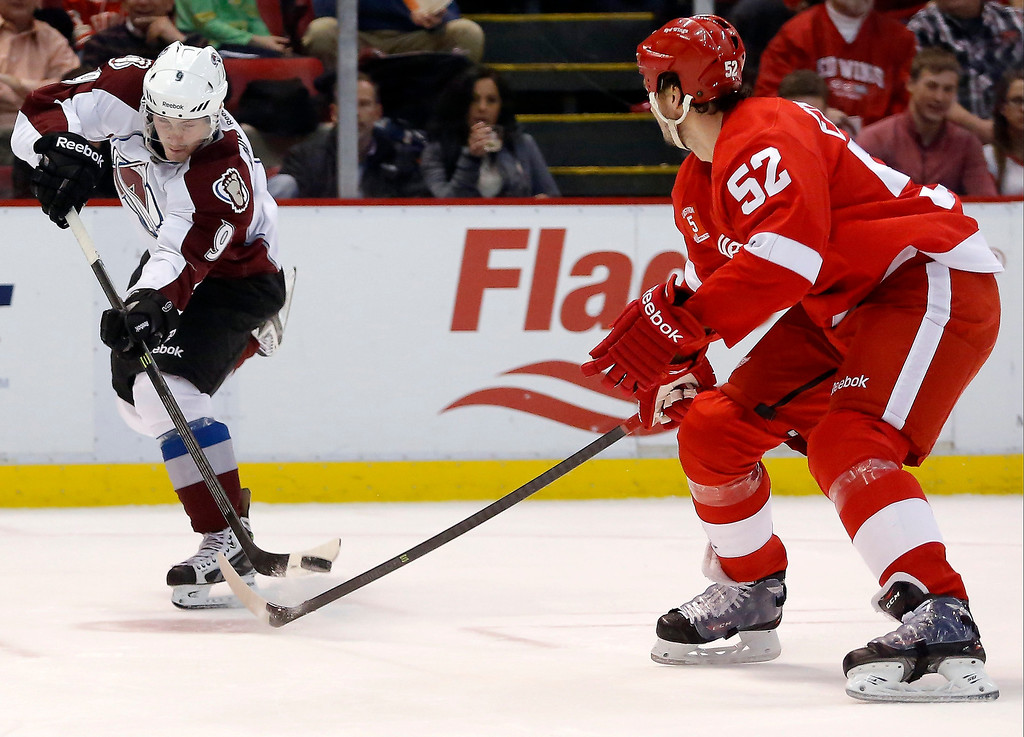 . Colorado Avalanche\'s Matt Duchene (9) takes a shot on goal against Detroit Red Wings\' Jonathan Ericsson (52), of Sweden, during the first period of an NHL hockey game Thursday, March 6, 2014, in Detroit. (AP Photo/Duane Burleson)