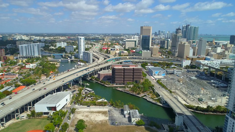 Aerial drone footage Downtown Miami Florida highways river scenic
