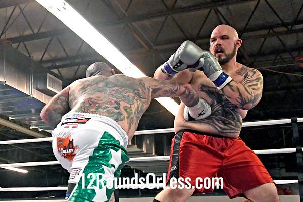 Sixth Pro Bout=B13, Main Event Travis Clark, White + Green Trunks -vs- Matt Garretson, Red + Black Trunks, Heavyweight Pro Boxing
