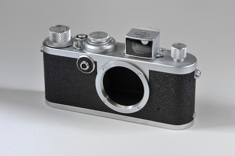 Leica IF body with added Zeiss Ikon 5.5cm finder. Condition cosmetically is mint minus. The shutter fabric is good. When I first picked up the camera the shutter speeds were not good. With a little exercise they began to function properly and now seem fine. The added viewfinder is screwed into the same four holes that held the two shoes that were on the original camera. It would be very simple to replace the original shoes if you have them.