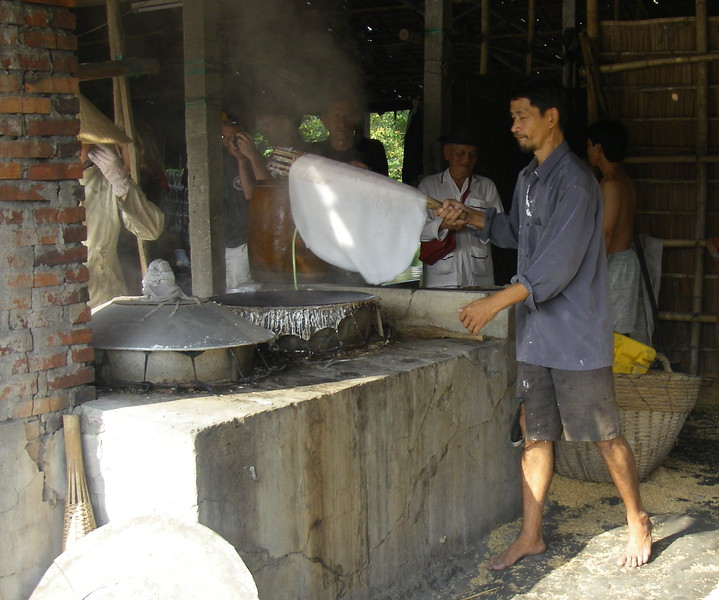 Making sheets of rice flour that will be cut into rice noodles
