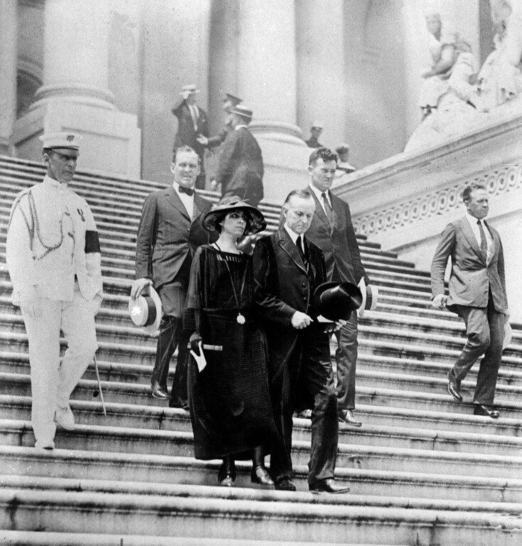 . U.S. President Calvin Coolidge, right foreground, and first lady Grace Coolidge, left, attend the viewing for the late President Warren G. Harding, lying in state, in Washington, D.C., in August 1923.  Harding died of a heart attack while in San Francisco, Ca., on Aug. 2.  (AP Photo)