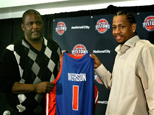 Description of . Allen Iverson, the newest addition to the Detroit Pistons lineup, right, holds up his new jersey with team president Joe Dumars during a news conference at the Palace in Auburn Hills, Mich., Tuesday, Nov. 4, 2008.  The Pistons acquired Iverson from the Denver Nuggets for All-Star point guard and former finals MVP Chauncey Billups, top reserve Antonio McDyess and project Cheikh Samb.  (AP Photo/Carlos Osorio)