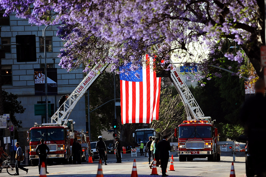 . A flag is hung over Temple St. during the funeral for LAPD Officer Roberto Sanchez in Los Angeles, CA May 14, 2014.  Sanchez was killed in a hit-and-run crash involving a SUV driver who is accused of deliberately ramming the officer\'s patrol car in Harbor City.(Andy Holzman/LA Daily News)