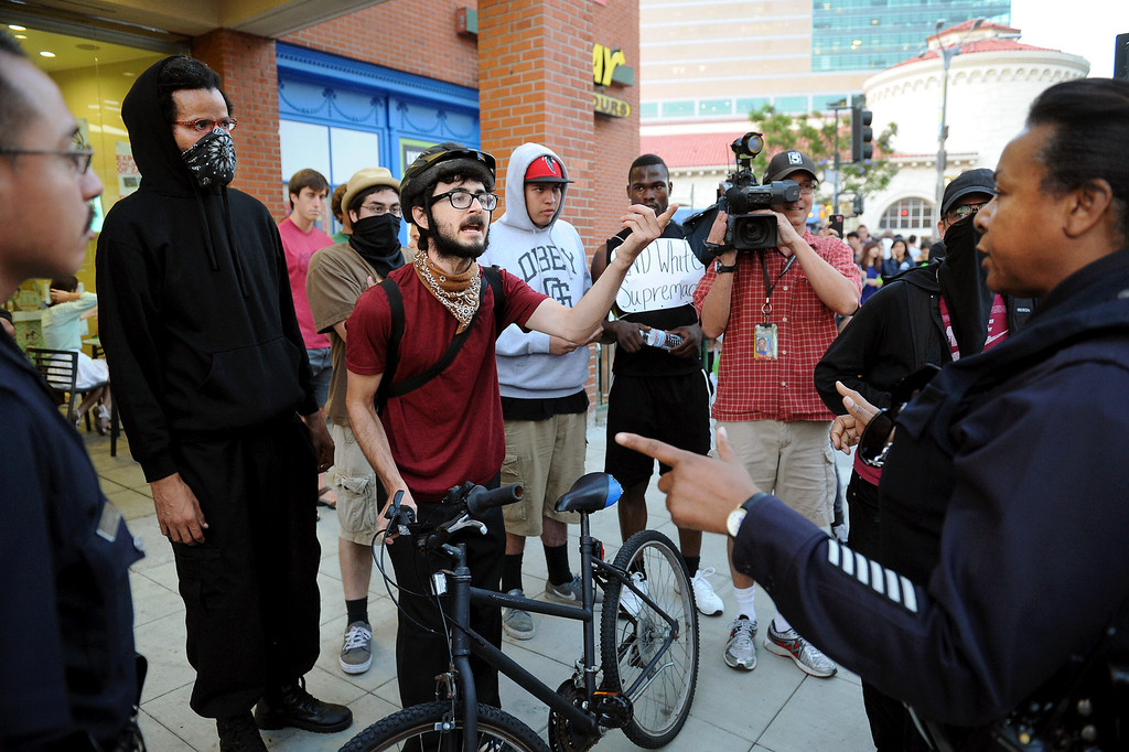 """. A protester argues with LAPD during a \""""Smash White Supremacy Fun Run\"""" in Westwood, Thursday, July 18, 2013. (Michael Owen Baker/L.A. Daily News)"""