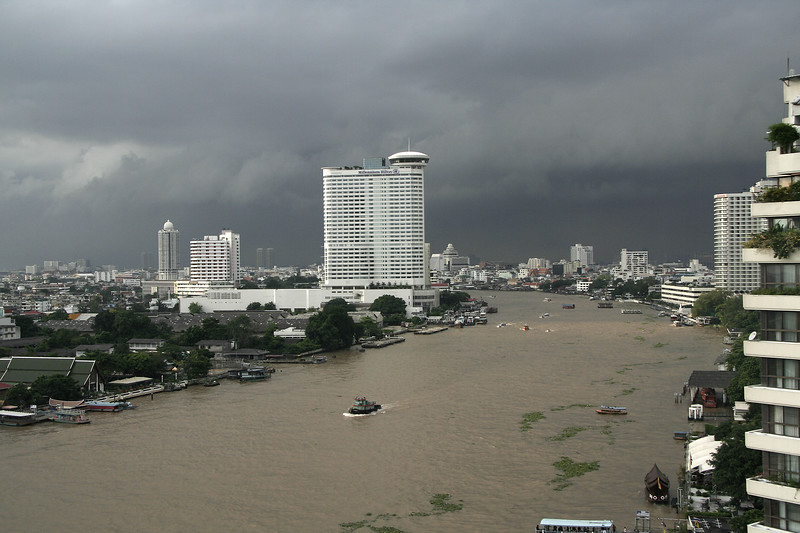 A view up the river with some ominous monsoon clouds rolling in.