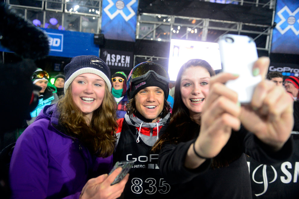 Description of . ASPEN, CO. - JANUARY 24: Taryn Gaquin (left), 18, and Cassie Stiepock pose with Louie Vito for a picture after his run during the men's Snowboard Superpipe elimination. Men's Snowboard Slopestyle elimination X Games Aspen Buttermilk Mountain Aspen January 24, 2013 (Photo By AAron Ontiveroz / The Denver Post)