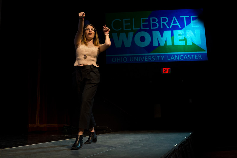 "LANCASTER, OHIO   MARCH 23, 2018: Michelle Poler, founder of Hello Fears, dances in front of the crowd as she takes the stage in the Wagner Theatre as one of the keynote speakers during the Celebrate Women Conference 2018, themed ""Recognizing Our Superpowers"" on March 23, 2018 at Ohio University Lancaster in Lancaster, Ohio.  Ty Wright photo"