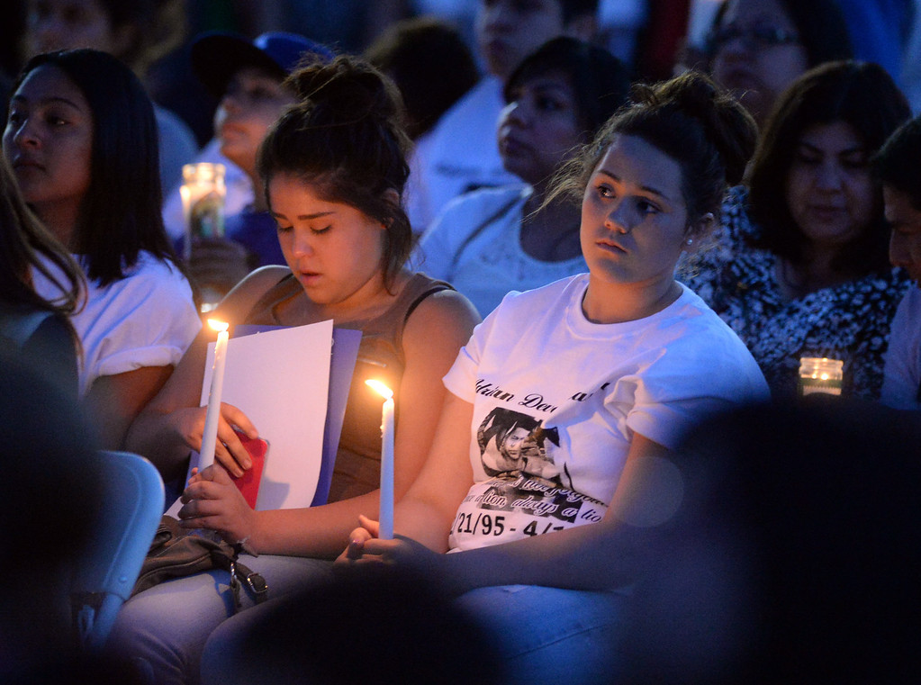 . Students hold candles as family, students and members of the community gather in memory of Adrian Castro, 19, at El Monte High School Monday evening April 14, 2014. Castro was one of nine students killed in the bus crash in Orland, Calif. (Staff Photo by Keith Durflinger/San Gabriel Valley Tribune)