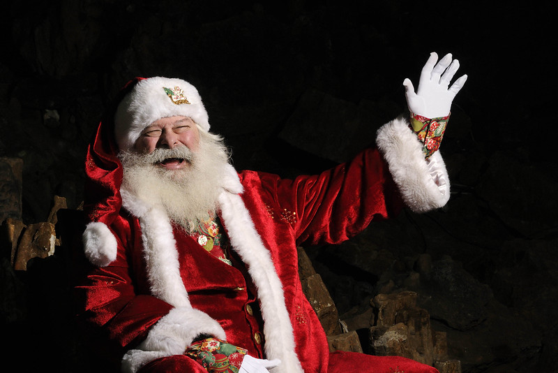 A very jolly Santa Claus waves during a special Christmas event at Cherokee Caverns in Knoxville, TN on Sunday, December 14, 2014. Copyright 2014 Jason Barnette