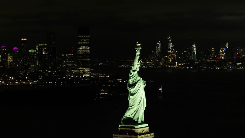 Statue of Liberty epic drone footage night city view
