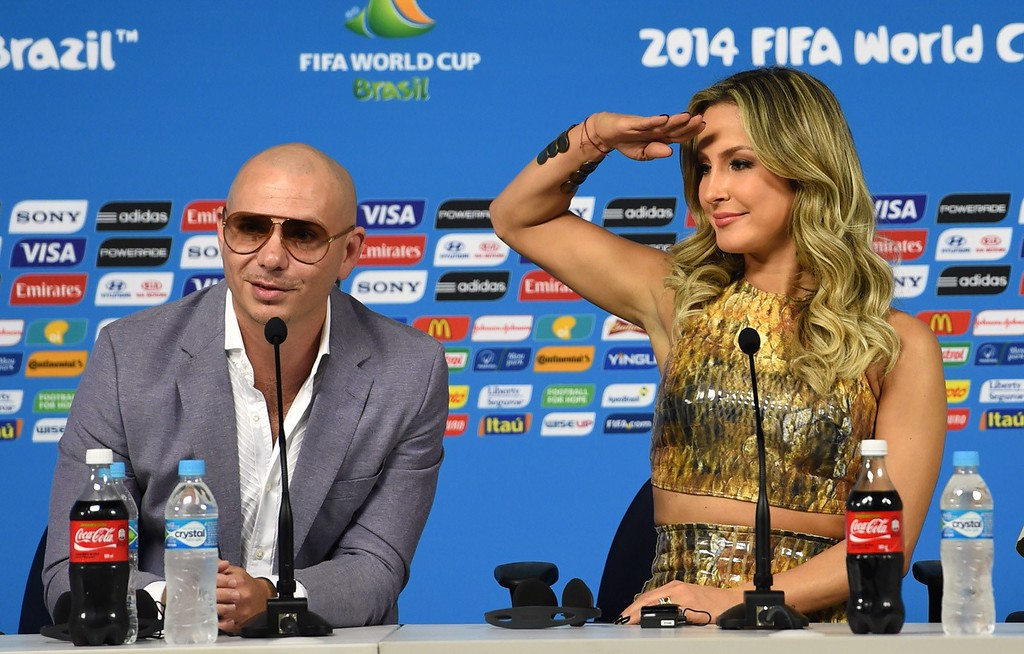 ". The performers of Brazil\'s World Cup official theme song ""We are one\"" Pitbull and Claudia Leitte, speak during a press conference in Sao Paulo, Brazil on June 11,  2014 on the eve of the opening match of the 2014 FIFA World Cup in Brazil. AFP PHOTO/PEDRO UGARTE/AFP/Getty Images"