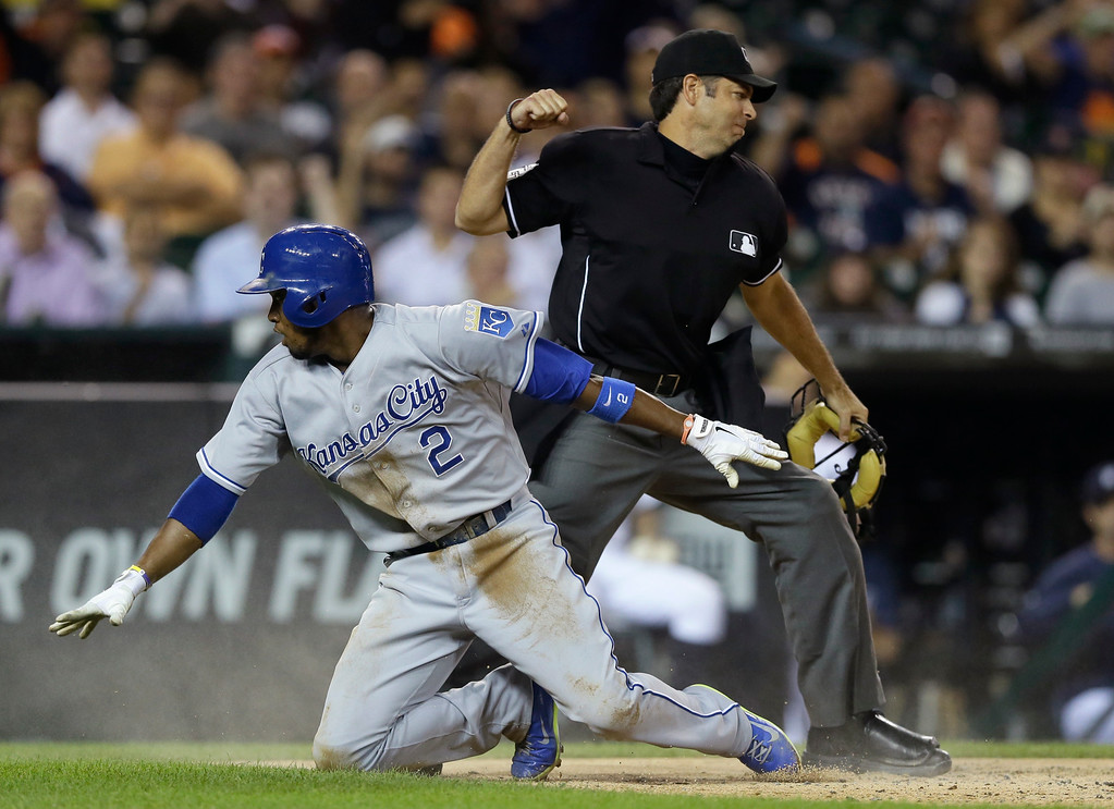 . Home plate umpire James Hoye calls out Kansas City Royals\' Alcides Escobar after he tries scoring from third on a fielder\'s choice during the third inning of a baseball game against the Detroit Tigers in Detroit, Wednesday, Sept. 10, 2014. (AP Photo/Carlos Osorio)