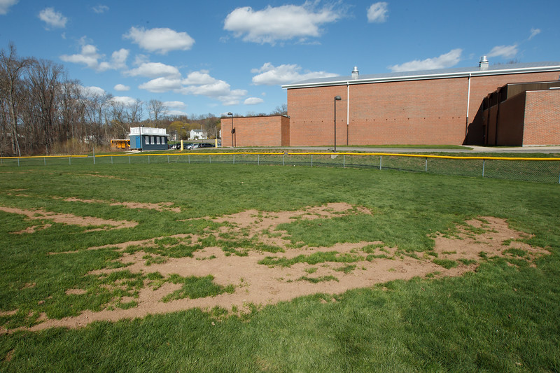 Bald area in the outfield mark the area where a landscaping machine got stuck and had to be pulled out damaging the field Tuesday at Lyman hall High School in Wallingford  Apr. 28, 2015 | Justin Weekes / For the Record-Journal