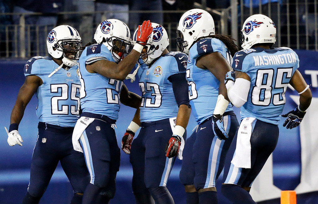 . Tennessee Titans running back Chris Johnson, second from left, celebrates with teammates including running back Darius Reynaud (25), running back Jamie Harper (23) and wide receiver Nate Washington (85) after running for a 94-yard touchdown against the New York Jets in the second quarter of an NFL football game, Monday, Dec. 17, 2012, in Nashville, Tenn. (AP Photo/Wade Payne)