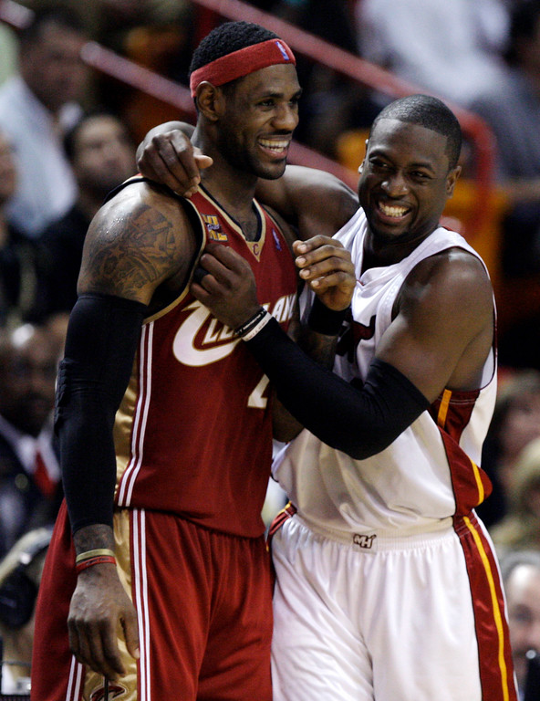 . Cleveland Cavaliers forward LeBron James, left, jokes with Miami Heat guard Dwyane Wade in the second quarter during an NBA basketball game in Miami, Thursday, Nov. 12, 2009. (AP Photo/Lynne Sladky)