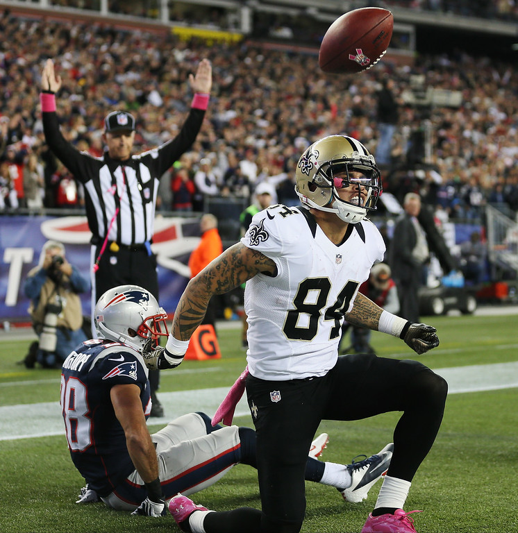 . Wide receiver Kenny Stills #84 of the New Orleans Saints celebrates after scoring a touchdown in the fourth quarter against the New England Patriots during the Saints 30-27 loss at Gillette Stadium on October 13, 2013 in Foxboro, Massachusetts.  (Photo by Rob Carr/Getty Images)