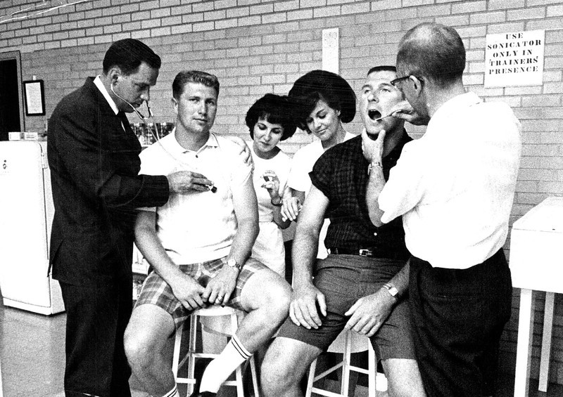 . July 16, 1965: Dr. E. H. Evanson examined Mickey Slaughter, second from left, while fellow quarterback John McCormick had his teeth checked on physical exam day. (The Denver Post)